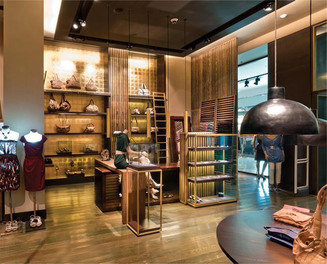 Blue mall interiores for Tiendas adolfo dominguez valencia